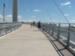 Dave Sell walking with his grandson on the Bob Kerrey Bridge.